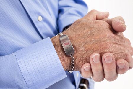 Man wearing medical information bracelet