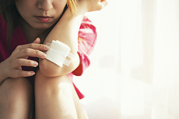 Girl with bandage on elbow