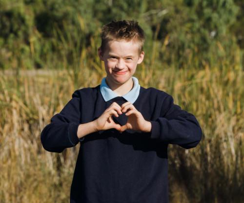 Boy holding hands as love heart