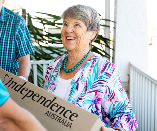 Woman receiving Independence Australia parcel